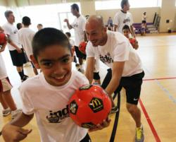 Youth with special health care needs play basketball